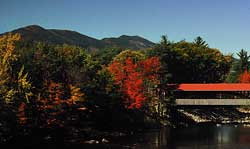 one of the White Moountains several covered bridges during the colorful foliage of fall